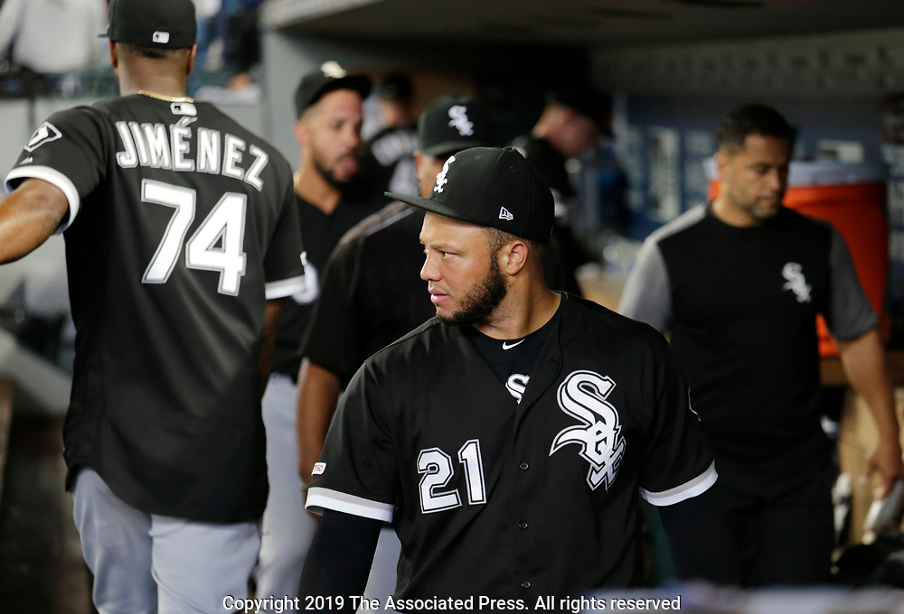 Chicago White Sox players including Welington Castillo leave the dugout after the 11-10 loss the Seattle Mariners in a baseball game, Sunday, Sept. 15, 2019, in Seattle. (AP Photo/John Froschauer)
