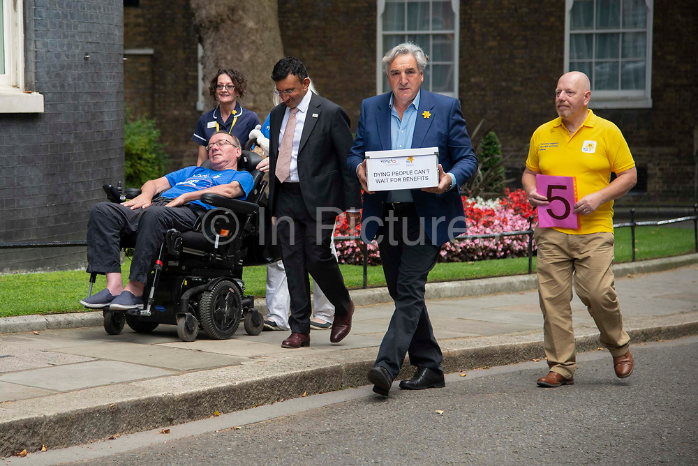 Marie Curie ambassador and actor, Jim Carter hands in a petition alongside health care professionals and sufferers of Motor Nuerones Disease to 10 Downing Street on 7 August, 2019 in London, United Kingdom. A petition signed by readers of the Daily Express newspaper demanding the government provide quick access to benefits for terminally ill people.
