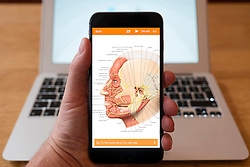 Using iPhone smartphone to display image of human head from human anatomy medical educational app