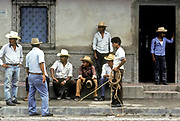 Cattle ranchers compare notes on the price of their stock, Anamoros village, El Salvador.