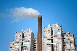 Smoke emissions from urban coal fired power station very close to modern upmarket apartment buildings in central beijing 2009