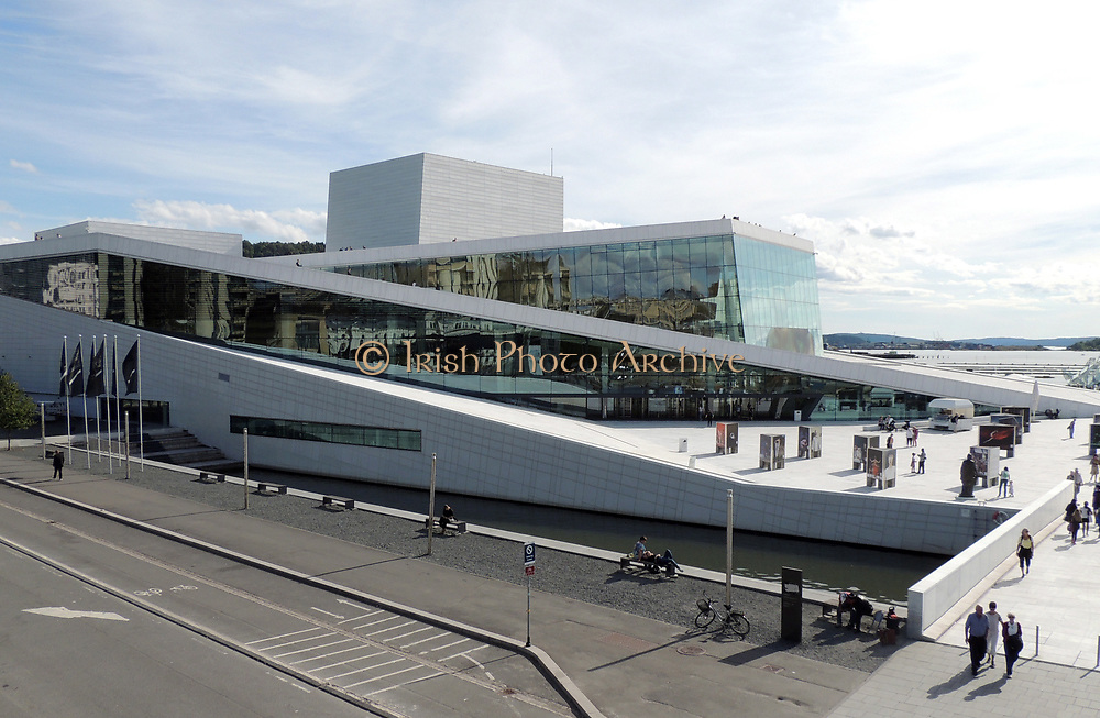 The Oslo Opera House (Operahuset) home of The Norwegian National Opera and Ballet, and the national opera theatre in Norway. The building is situated in the Bjørvika neighborhood of central Oslo, at the head of the Oslofjord. A design competition was held and the judges chose that of the Norwegian firm Snøhetta. Construction started in 2003 and the completed in 2007. It was opened in April 2008.