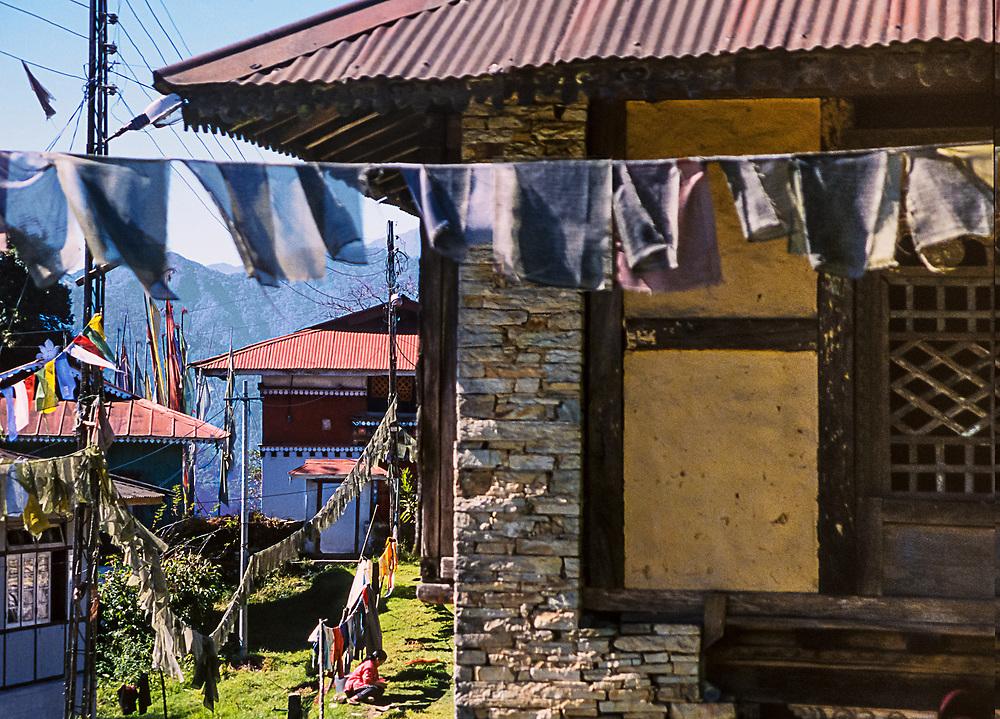 washing on the line under prayer flags at Rumtek Monastery
