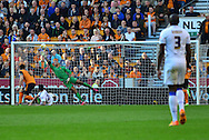 Alex Mowatt scores Leeds third goal and the equaliser during the Sky Bet Championship match between Wolverhampton Wanderers and Leeds United at Molineux, Wolverhampton, England on 6 April 2015. Photo by Alan Franklin.
