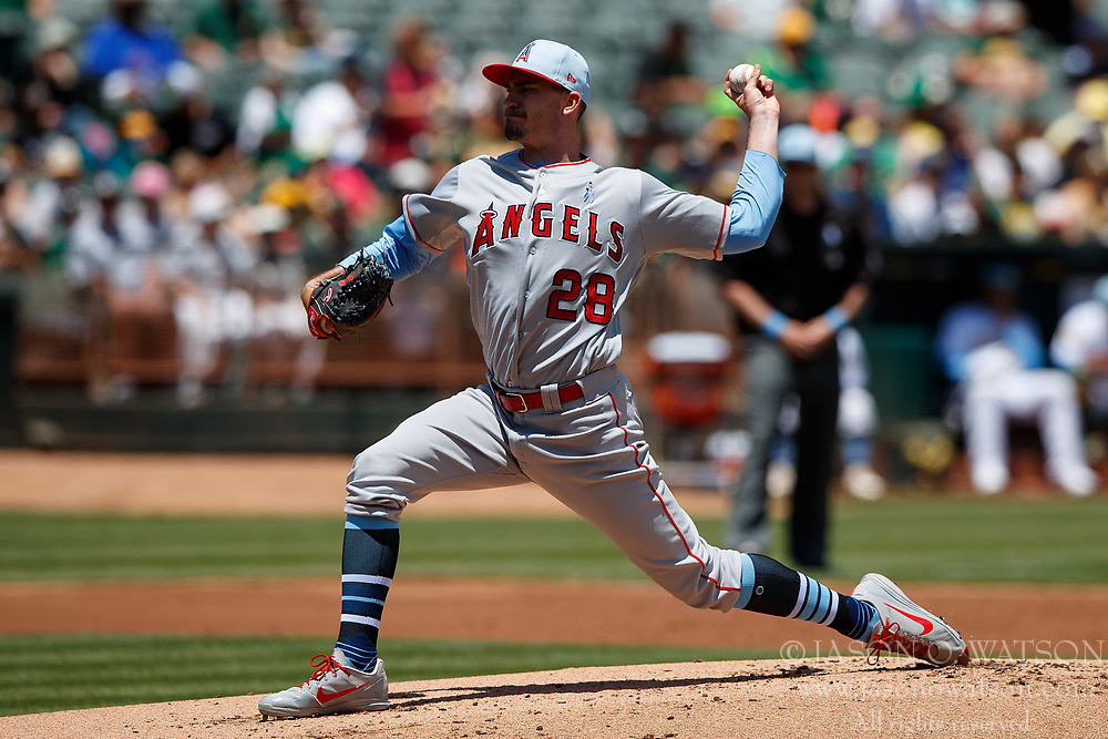 OAKLAND, CA - JUNE 17: Andrew Heaney #28 of the Los Angeles Angels of Anaheim pitches against the Oakland Athletics during the first inning at the Oakland Coliseum on June 17, 2018 in Oakland, California. The Oakland Athletics defeated the Los Angeles Angels of Anaheim 6-5 in 11 innings. (Photo by Jason O. Watson/Getty Images) *** Local Caption *** Andrew Heaney