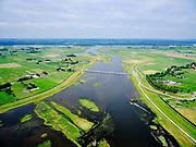 """Nederland, Overijssel, Gemeente Kampen; 21–06-2020; het Reevediep richting monding in het Revemeer (voorheen Drontermeer), Flevoland aan de horizon. In het midden  de Nieuwendijkbrug, met deel van De Enk in de voorgrond. Voor de aanleg van het Reevediep liep ter hoogte van dit natuurgebied in Kamperveen het riviertje Reeve.<br /> Het Reevediep is aangelegd in het kader van het project Ruimte voor de Rivier om bij hoogwater water af te voeren voordat dit het nabij gelegen Kampen bereikt, direct naar het IJsselmeer, de 'bypass Kampen'. Het Reevediepgebied is ook een natuurgebied en vormt een ecologische verbindingszone tussen rivier de IJssel en Drontermeer.<br /> Reevediep towards the mouth in the Revemeer (formerly Drontermeer). The Nieuwendijkbrug, Flevoland on the horizon.<br /> The Reevediep has been constructed as part of the Room for the River project, and functions to discharge high waters before reaching the nearby Kampen, directly to the IJsselmeer, the """"bypass Kampen"""". The Reevediep area is also a nature reserve and forms an ecological connecting zone between the river IJssel and Drontermeer.<br /> <br /> luchtfoto (toeslag op standard tarieven);<br /> aerial photo (additional fee required)<br /> copyright © 2020 foto/photo Siebe Swart"""