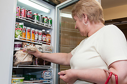 Pensioner in supported housing, shopping