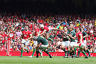 Leigh Halfpenny of Wales collides with South Africa's  Joe Van Niekerk (8). Wales v South Africa,    at Millennium Stadium in Cardiff on Sat 5th June 2010. pic by Andrew Orchard,  Andrew Orchard sports photography,