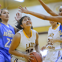 Tohatchi Cougar Cheyenne Begay (30) presses into the Dulce Hawks defense Friday at Tohatchi High School.