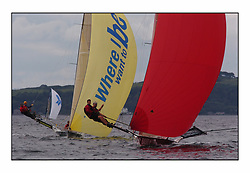 The 2004 Skiff Nationals at Largs held by the SSI.<br /> <br /> Tyrell Wines helmed by Mike Wilkie with Base 1 helmed by Rob Dulson<br /> <br /> Marc Turner / PFM Pictures