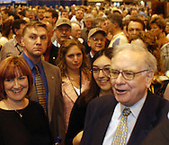 5/1/04 Omaha, Neb.  Warren Buffett stolls through Berkshire Hathaway shareholders meeting at Qwest Center Omaha Saturday morning with the media and his entourage in tow.  (Photo by chris machian)