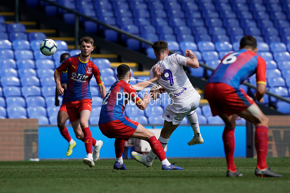 Ryan Edmondson of Leeds United U23 shoots during the U23 Professional Development League match between U23 Crystal Palace and Leeds United at Selhurst Park, London, England on 15 April 2019.