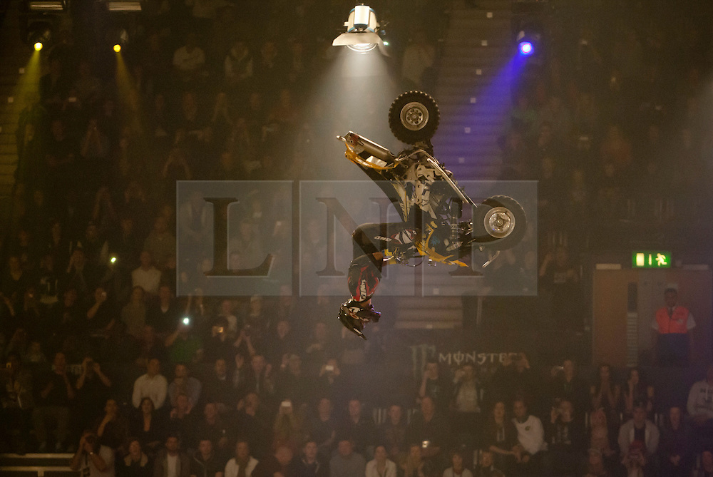 © licensed to London News Pictures. London, UK 14/03/2012. An ATV (all terrain vehicle) rider  performing a stunt during the Masters of Dirt show at Wembley Arena in London on March 14th, 2012. The Masters of Dirt show features top European freestyle riders performing some stunts on motocross motorcycles, along with a host of other machines including minibikes and quads. Photo credit: Tolga Akmen/LNP