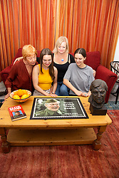 Clive Dunn's widow Priscilla Morgan, grand daughters Alice and Lydia and daughter Jessica admire a stamp design featuring Dad's Army's Clive Dunn. London, June 04 2018.
