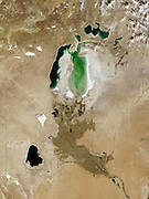 The Aral Sea, October 2008. Once fourth largest inland sea, in southern Kazakhstan and northern Uzbekistan it has divided into three bodies of water. Major cause of shrinkage due to  diversion of water to agriculture.  Credit NASA.