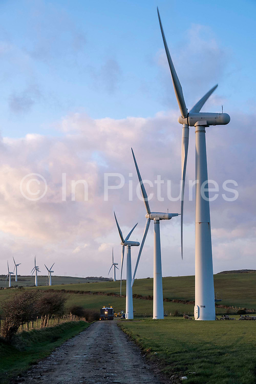 An access road to wind turbines on Llyn Alaw Wind Farm in full electricity production during the tail end of Storm Dennis on 17th February 2020 in Anglesey, Wales, United Kingdom. Llyn Alaw Wind Farm is located on Anglesey in North Wales, it consists of 34 turbines with a capacity of 20.4 MW mega watts and can produce an average 60,000 kilowatt hours KWh each year. This is enough to provide electricity for 14,000 homes in the local community.