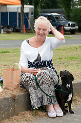 Margaret Sixsmith and her dog Bracken enjoying one of the 500 free picnics given away during Picnic in the park event in the grounds of Goldthorpe Welfare hall on wednesday<br /> 121340<br /> 15 August 2012<br /> Image © Paul David Drabble