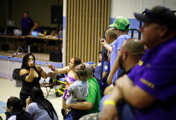 12 March 2016. Metairie, Louisiana.<br /> Wrestling action from Wildkat Sports and Entertainment's 'March into Mayhem' at the Meisler Middle School.<br /> Ruby Raze and Kennadi Brink defeat Renee Michelle. Amaiya Jade is taken away with concussion. A kid shows his displeasure with the victors at the end of the bout.<br /> Photo©; Charlie Varley/varleypix.com