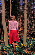 A912GE Young girl walking into dark woods with her back to the camera