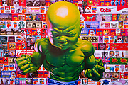 "Glastonbury Festival, 2015. Shangri La is a festival of contemporary performing arts held each year within Glastonbury Festival. The theme for the 2015 Shangri La was Protest. Action figure of ""Baby Hulk"" as an art work poster."