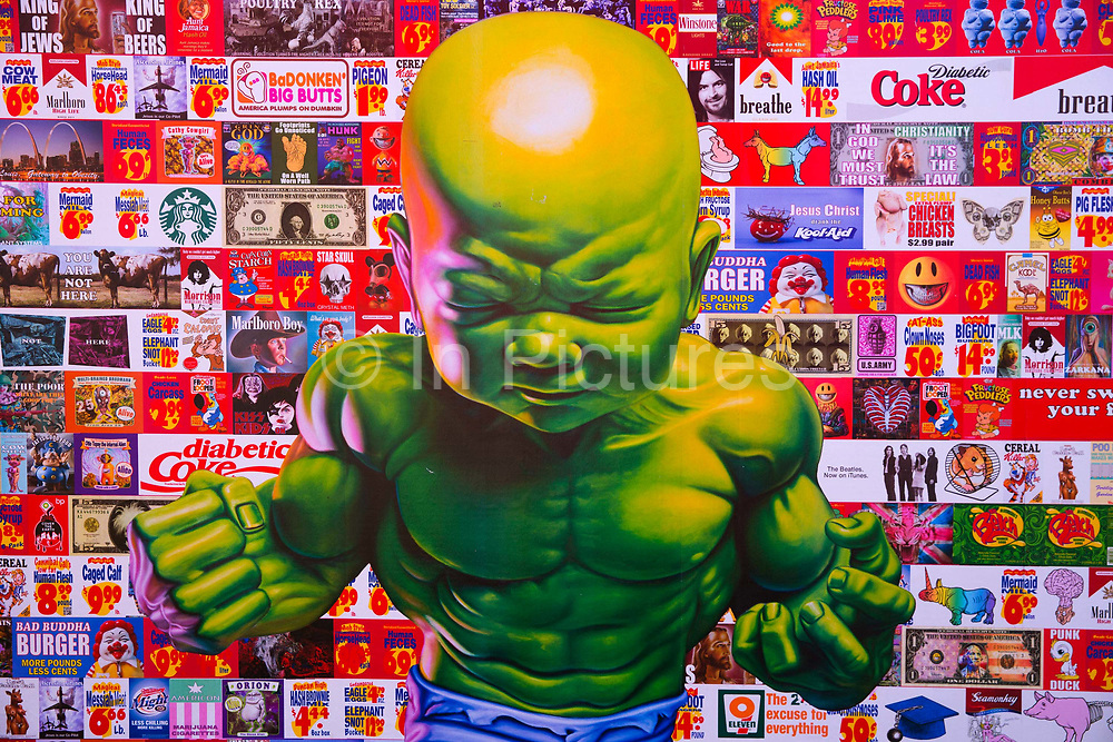 """Glastonbury Festival, 2015. Shangri La is a festival of contemporary performing arts held each year within Glastonbury Festival. The theme for the 2015 Shangri La was Protest. Action figure of """"Baby Hulk"""" as an art work poster."""