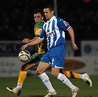 Photo: Ashley Pickering/Sportsbeat Images.<br /> Colchester United v Norwich City. Coca Cola Championship. 15/12/2007.<br /> Danny Granville of Colchester (R) tries to get around Jimmy Smith of Norwich