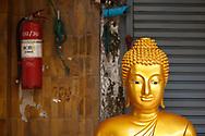 Buddha statue for sale on the street at Bamrung Muaeng, Bangkok, Thailand