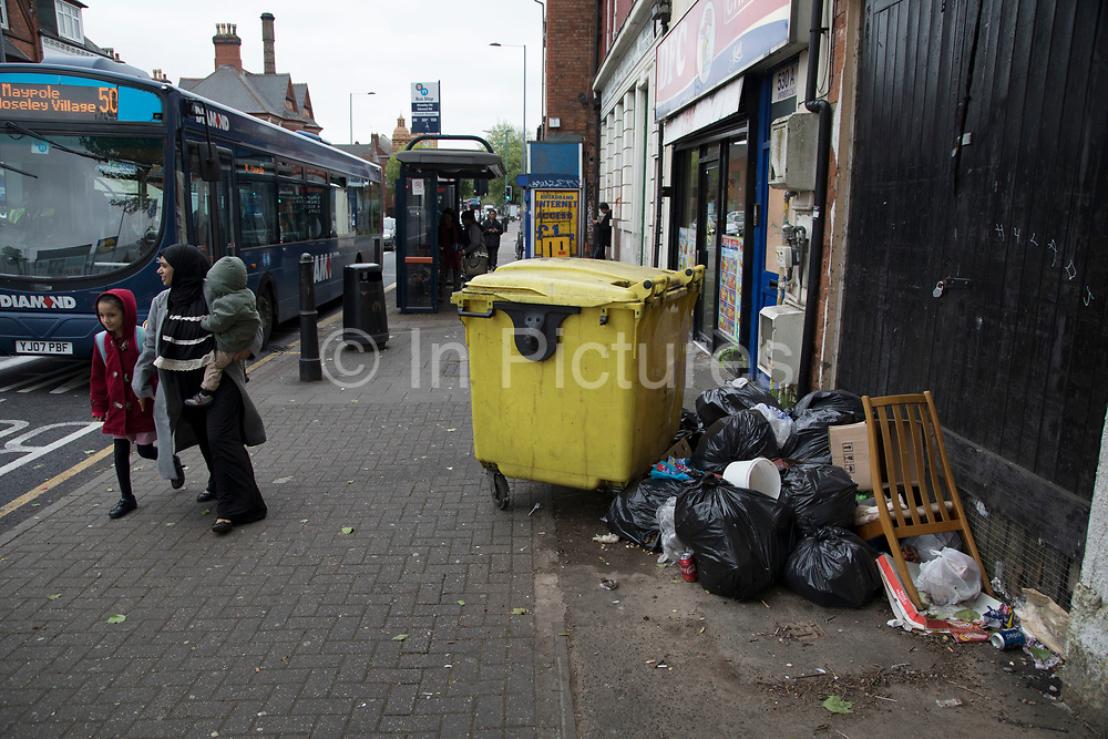 Street scene of rubbish in Moseley, Birmingham, United Kingdom. Moseley is known as one of the more up market neighbourhoods in Birmingham, but still shows signs of downturn, and lack of consistent investment and general upkeep away from the residential areas, like here on Moseley Road.