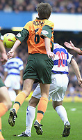 Picture: Raymond Field<br /><br />Queens Park Rangers v Plymouth Argyle nationwide league division two<br /><br />15/11/2003<br />Steve Adams makeing Kiven McLeod's live very difficult.
