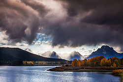 """Autumn Storm, Grand Teton National Park. A menacing storm mutes the golden hues of autumn but illuminates with a different kind of grandeur.<br /> <br /> For production prints or stock photos click the Purchase Print/License Photo Button in upper Right; for Fine Art """"Custom Prints"""" contact Daryl - 208-709-3250 or dh@greater-yellowstone.com"""