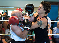 Federal Liberal Leader Justin Trudeau, right, boxes Mickey MacDonald, a Halifax-area entrepreneur and philanthropist, at Palooka's Gym in Bedford, N.S. on Monday, August 25, 2014. MacDonald, a former competitive boxer, is hosting a fund-raising event at his residence for Trudeau later in the day. THE CANADIAN PRESS/Andrew Vaughan /ABACAPRESS.COM  | 521043_024 Bedford Canada