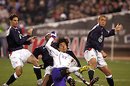 10 February 2006: Japan's Yuji Nakazawa (22) gets a shot off while being marked by Heath Pearce (6), Eddie Pope (behind), and Jimmy Conrad (12), of the United States. The United States Men's National Team defeated Japan 3-2 at SBC Park in San Francisco, California in an International Friendly soccer match.