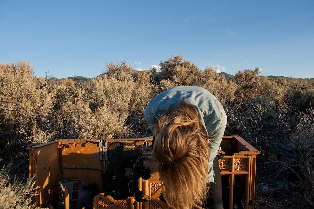 Self portrait taken on a vacant lot in Ranchos De Taos, May 2011.