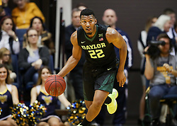 Jan 9, 2018; Morgantown, WV, USA; Baylor Bears guard King McClure (22) dribbles up the floor during the first half against the West Virginia Mountaineers at WVU Coliseum. Mandatory Credit: Ben Queen-USA TODAY Sports