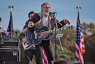 """Yusuf Islam (formerly Cat Stevens) performing  at the """"Rally to Restore Sanity And/Or Fear"""". A crowd estimated  between 100,000- 200,000  came from across America  to the National Mall on October 30, 2010 before the midterm elections to participate in the """"Rally to Restore Sanity And/Or Fear"""" . Jon Stewart insists the rally was not a political event, however; the audience had messages of their own on hand made signs for the occasion, many with a political message."""