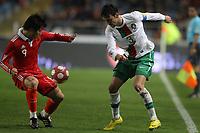 20100303: COIMBRA, PORTUGAL - Portugal vs China: International Friendly. In picture: Paulo Ferreira (Portugal) and Hao Junmin (China). PHOTO: CITYFILES