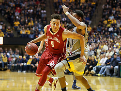 Jan 6, 2018; Morgantown, WV, USA; Oklahoma Sooners center Jamuni McNeace (4) attempts to drive to the basket during the first half against the West Virginia Mountaineers at WVU Coliseum. Mandatory Credit: Ben Queen-USA TODAY Sports
