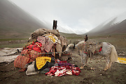 All of the Khan's wordly goods. Moving with the Khan (chief) family from the Qyzyl Qorum camp to the summer camp of Kara Jylga, on the south side of the wide Little Pamir plateau...Trekking through the high altitude plateau of the Little Pamir mountains (average 4200 meters) , where the Afghan Kyrgyz community live all year, on the borders of China, Tajikistan and Pakistan.