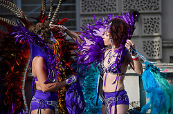 © Licensed to London News Pictures. 29/08/2016. London, UK. Carnival goers prepare their costumes ahead of day two of the Notting Hill carnival, the second largest street festival in the world after the Rio Carnival in Brazil, attracting over 1 million people to the streets of West London.  Photo credit: Ben Cawthra/LNP