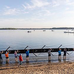 A morning rowing club (Portland Community Rowing Association) finishing a trip near the Eastern Promenade in Portland, Maine.