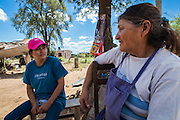 2014/11/22 – Quimili, Argentina: Simone Dominguez (67) speaks with her daughter, Fabiana Carrizo (40) regarding the airplanes used to pulverize her house with glyphosate, in order to make her feel unsafe and to force her to abandon the land where she lives at allotment number 5 of the Guaycurú Indigenous Community. The indigenous people in the area are being threaten by soy producers that see their land as an opportunity to grow more of the crop. On the otherhand indigenous defend a sustainable agriculture and to live in harmony with the nature. (Eduardo Leal)