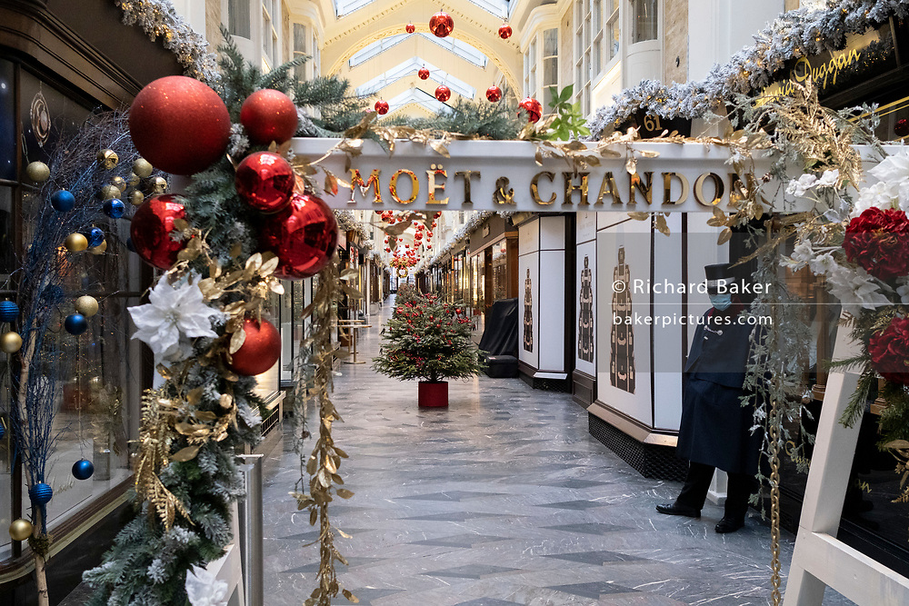 Four days before Christmas, retailers in Burlington Arcade remain closed after the government's last-minute u-turn on the easing of Coronavirus pandemic rules. London and the South-East has been put under a Tier 4 restriction, forcing the closure of non-essential shops and small businesses, on 21st December 2020, in London, England.