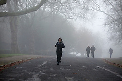© Licensed to London News Pictures. 27/11/2020. London, UK. Runners in dense fog in Finsbury Park, north London. Freezing cold and foggy weather is forecast across many parts of the UK. Photo credit: Dinendra Haria/LNP