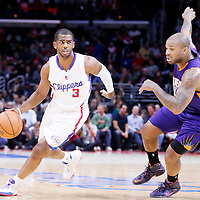 08 December 2014: Los Angeles Clippers guard Chris Paul (3) drives past Phoenix Suns forward P.J. Tucker (17) during the Los Angeles Clippers 121-120 overtime victory over the Phoenix Suns, at the Staples Center, Los Angeles, California, USA.