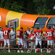 Kansas City Chiefs cornerbacks and safeties signed autographs for fans in front of the Weinermobile parked at the team's training camp on the campus of the University of Wisconsin-River Falls.