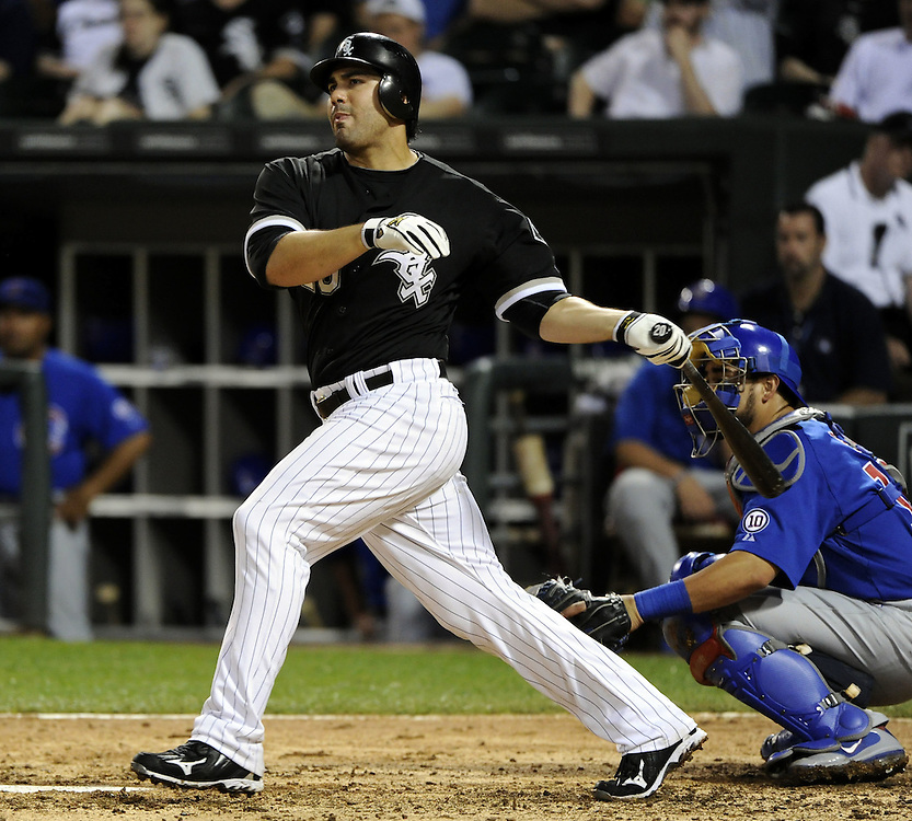 CHICAGO - JUNE 21:  Carlos Quentin #20 of the Chicago White Sox hits a double in the eighth inning against the Chicago Cubs on June 21, 2011 at U.S. Cellular Field in Chicago, Illinois.  The White Sox defeated the Cubs 3-2.  (Photo by Ron Vesely)  Subject:  Carlos Quentin