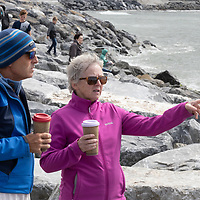 Nigel and Ann Philipson from Liscannor watching the start of the swim at the Annual Pat Conway and friends Charity Swim from Lahinch to Liscannor Pier in aid of the Burren Chernobyl Project