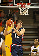 December 29 2010: Illinois Fighting Illini center Meyers Leonard (12) pulls down a rebound during the first half of an NCAA college basketball game at Carver-Hawkeye Arena in Iowa City, Iowa on December 29, 2010. Illinois defeated Iowa 87-77.