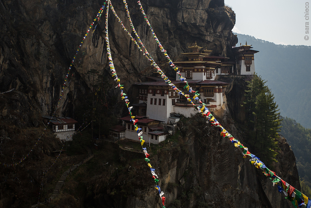 Prayer Flags over Tiger's Nest, over 2000 feet above the valley floor, in Paro, Bhutan