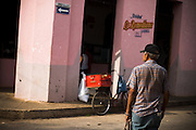 Man waiting to cross a street in Remedios, Cuba Thursday July 17, 2008.